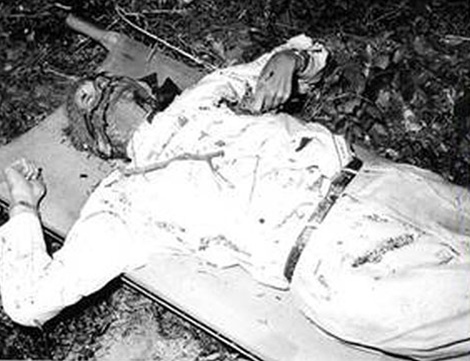 The body of Dag -- Notice the playing card in his left hand.